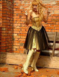 A long hair blonde posing outdoor in her cute yellow stockings has no shame